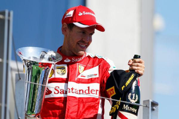 Hungaroring, Budapest, Hungary. Sunday 26 July 2015. Sebastian Vettel, Ferrari, 1st Position, on the podium with his trophy. World Copyright: Charles Coates/LAT Photographic ref: Digital Image _J5R8554
