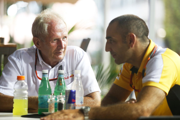 Marina Bay Circuit, Singapore. Saturday 19 September 2015. Helmut Markko, Consultant, Red Bull Racing, with Cyril Abiteboul, Head Engineer, Renault Sport F1. World Copyright: Alastair Staley/LAT Photographic ref: Digital Image _R6T6067