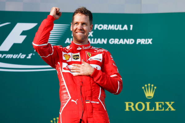 Albert Park, Melbourne, Australia. Sunday 26 March 2017. Sebastian Vettel, Ferrari, 1st Position, celebrates victory on the podium. World Copyright: Glenn Dunbar/LAT Images ref: Digital Image _X4I3889