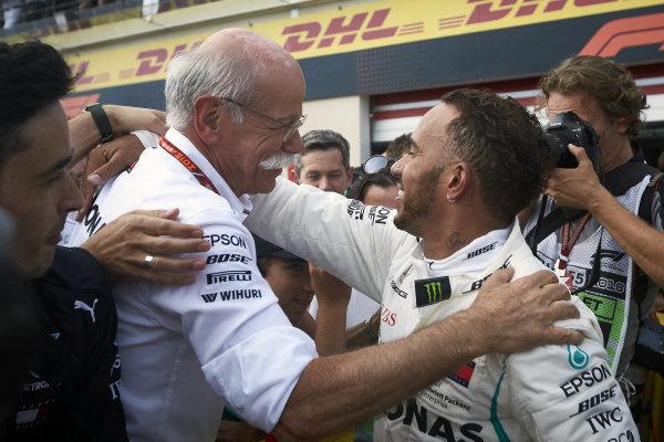 Lewis Hamilton, Mercedes AMG F1, 1st position, celebrates in Parc Ferme with Dr Dieter Zetsche, CEO, Mercedes Benz.