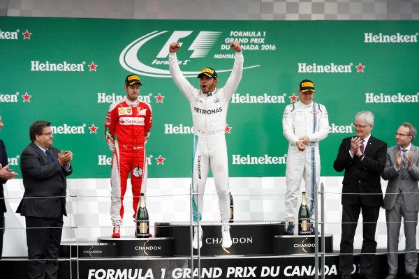 Circuit Gilles Villeneuve, Montreal, Canada. Sunday 12 June 2016. Lewis Hamilton, Mercedes AMG celebrates on the podium with Sebastian Vettel, Ferrari and Valtteri Bottas, Williams Martini Racing. World Copyright: Glenn Dunbar/LAT Photographic ref: Digital Image _V2I5497