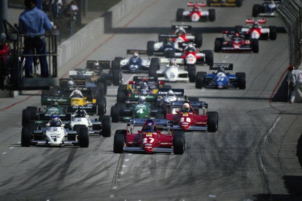 Patrick Tambay, Ferrari 126C2B, leads from Keke Rosberg, Williams FW08C Ford, Jacques Laffite, Williams FW08C Ford, and René Arnoux, Ferrari 126C2B, at the start.