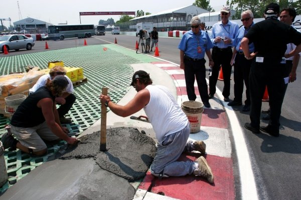 Charlie Whiting (GBR) FIA Delegate and Herbie Blash (GBR) FIA oversee the re-cementing of the final chicane.Formula One World Championship, Rd 8, Canadian Grand Prix, Preparations, Montreal, Canada, 9 June 2005.DIGITAL IMAGE