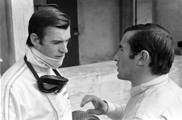 Chris Irwin (GBR) BRM P83 (left) talking with Jackie Stewart (GBR) BRM P115.  Italian Grand Prix, Monza 10 September 1967.