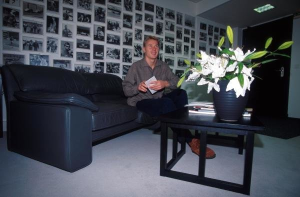 Mika Hakkinen (FIN) with pictures of his achievements on his wall. Formula One Drivers At Home, Monte Carlo, Monaco, 1999.