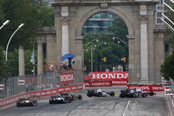 20 July, 2014, Toronto, Ontario, Canada Ryan Briscoe leads a group into turn 1 ©2014, Michael L. Levitt LAT Photo USA