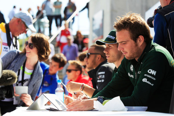 Silverstone, Northamptonshire, England 29th June 2013 Giedo van der Garde, Caterham F1, and Charles Pic, Caterham F1, sign autographs for fans World Copyright: Charles Coates/  ref: Digital Image _X5J2374