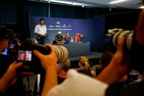 Red Bull Ring, Spielberg, Austria. Thursday 06 July 2017. Photographers take pictures of Lewis Hamilton, Mercedes AMG, Kevin Magnussen, Haas F1, and Sebastian Vettel, Ferrari, in the Thursday press conference. World Copyright: Andy Hone/LAT Images ref: Digital Image _ONZ8751