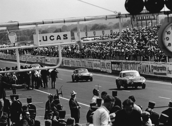 Le Mans, France. 19th - 20th June 1965.Paddy Hopkirk/Andrew Hedges (MGB), 11th position, leads Jean-Jacques Thuner/Simo Lampinen (Triumph Spitfire), 13th position, at the finish of the race, action. World Copyright: LAT Photographic.Ref: 1069 - 2A.