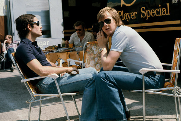 Jarama, Madrid, Spain. 26 - 28 April 1974. Jacky Ickx and Ronnie Peterson chat in the paddock, portrait.  World Copyright: LAT Photographic. Ref: 74ESP13