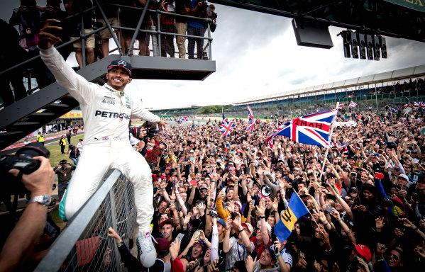 Silverstone, Northamptonshire, UK.  Sunday 16 July 2017. Lewis Hamilton, Mercedes AMG, 1st Position, celebrates victory with the British fans. World Copyright: Dunbar/LAT Images  ref: Digital Image _X4I8736