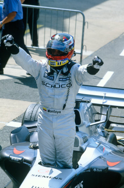 2005 British Grand Prix. Silverstone, England. 8th - 10th July 2005 Juan Pablo Montoya, McLaren Mercedes MP4-20 celebrates victory. World Copyright: Charles Coates/LAT Photographic Ref: 35mm Image A15