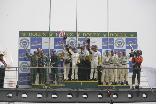 2006 Le Mans 24 Hours, Le Mans, France.14th - 18th June. O Gavin (GBR)/ O Beretta (MCO)/ J Magnussen (DNK), Corvette Racing, Corvette C6-R. T Enge (CZE)/ D Turner (GBR), Aston Martin Racing, Aston Martin DB9R. and L Alphand (FRA)/ P Goueslard (FRA), Luc Alphand Aventures, Corvette C5-R. Celebrate on the podium.World Copyright: Andrew Ferraro/LAT PhotographicRef: Digital Image Only ZP9O1586