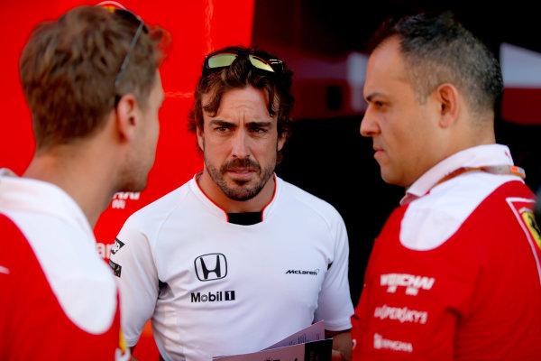 Hungaroring, Budapest, Hungary. Friday 22 July 2016. Sebastian Vettel, Ferrari, and Fernando Alonso, McLaren. World Copyright: Glenn Dunbar/LAT Photographic ref: Digital Image _W2Q6568