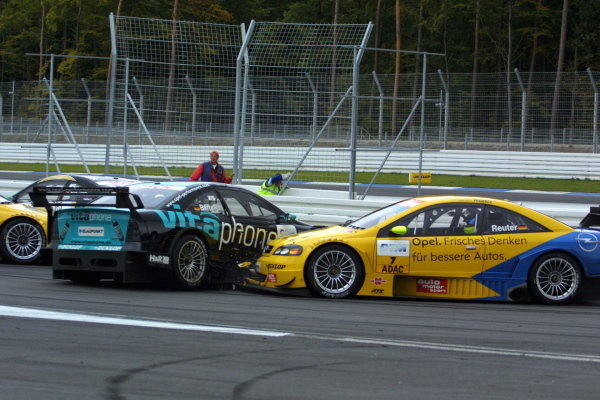 Manuel Reuter (GER), Opel Team Phoenix Astra Coupe, was forced to retire early when he was unable to avoid a collision with fellow Opel driver Michael Bartels (GER) Opel Team Holzer Astra Coupe.DTM Championship, Rd10, Hockenheim, Germany. 06 October 2002.DIGITAL IMAGE