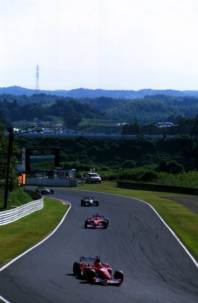 Race winner Michael Schumacher (GER) Ferrari F2002 leads the field.
