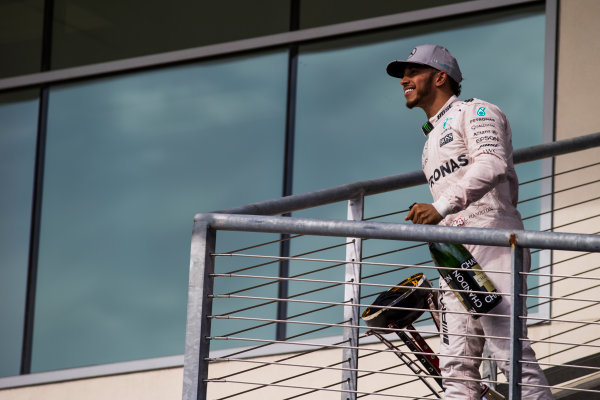 Circuit of the Americas, Austin Texas, USA. Sunday 23 October 2016. Lewis Hamilton, Mercedes AMG, 1st Position, with his trophy and Champagne. World Copyright: Sam Bloxham/LAT Photographic ref: Digital Image _SLA2721_1