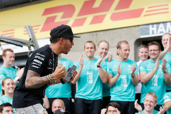 Circuit Gilles Villeneuve, Montreal, Canada. Sunday 7 June 2015. Lewis Hamilton, Mercedes AMG, 1st Position, celebrates with the Mercedes team. World Copyright: Alastair Staley/LAT Photographic. ref: Digital Image _R6T0065