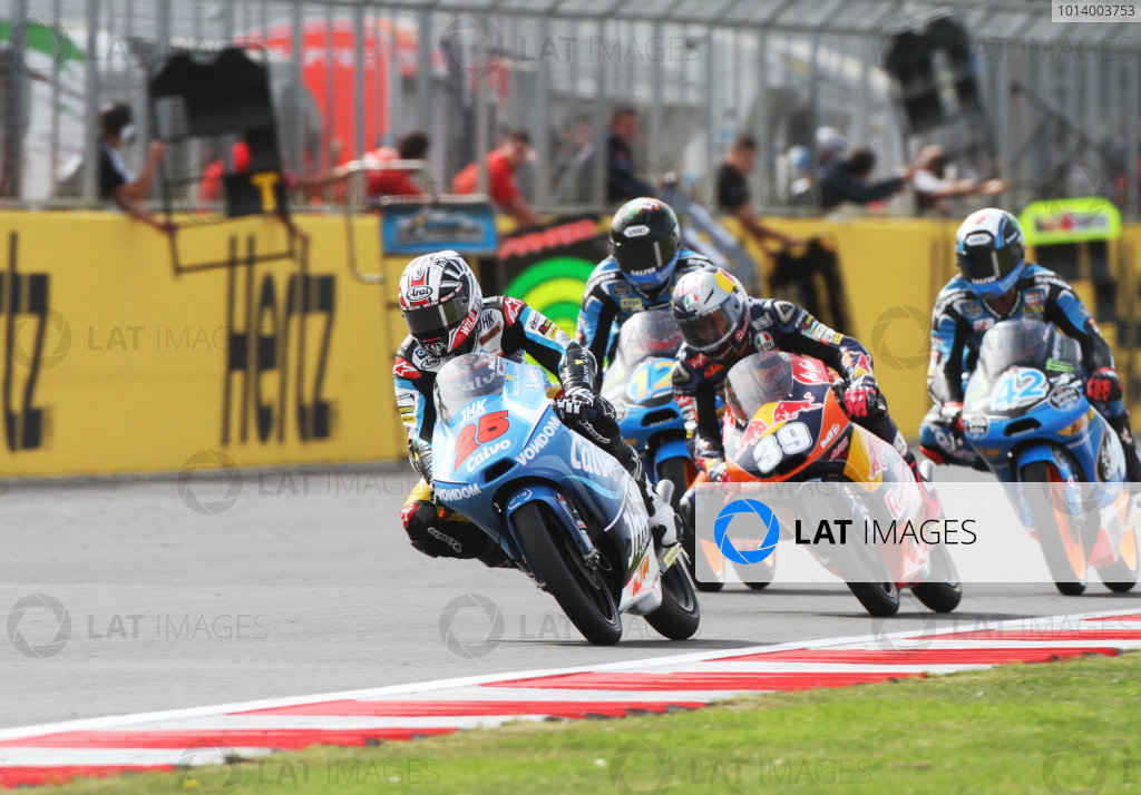 British Grand Prix.  Silverstone, England. 30th August - 1st September 2013.  Maverick Vinales, KTM, leads Luis Salom, KTM, Alex Marquez, KTM, and Alex Rins, KTM.  Ref: IMG_2647a. World copyright: Kevin Wood/LAT Photographic