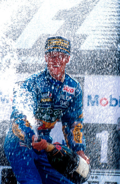 1994 Belgian Grand Prix.Spa-Francorchamps, Belgian.26-28 August 1994.Michael Schumacher (Benetton Ford) 1st position on the podium, but later disqualified because his skidblock or plank from the car's undertray was found to be below the required legal measurement. Ref-94 BEL 04.World Copyright - LAT Photographic