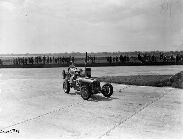 """An ERA leads """"B. Bira"""", Maserati."""