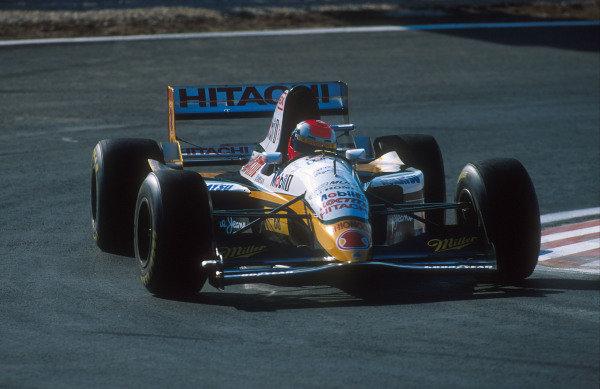 1994 Portuguese Grand Prix.Estoril, Portugal.23-25 September 1994.Johnny Herbert (Lotus 109 Mugen-Honda) 11th position.Ref-94 POR 01.World Copyright - LAT Photographic