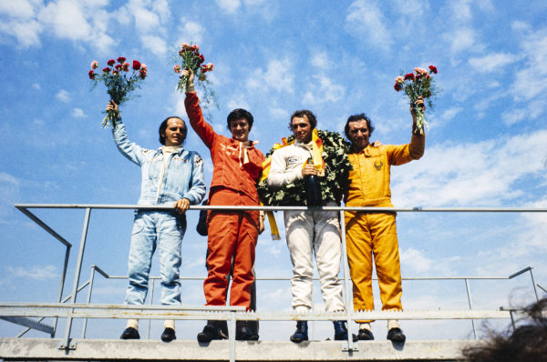 Podium: l to r: Jacques Coulon, 3rd position, Colin Vandervell, 2nd position, Jochen Mass, 1st position, Vittorio Brambilla, 4th position and 3rd in Heat 2.