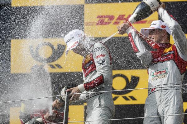 Podium: Race winner René Rast, Audi Sport Team Rosberg and second place Nico Müller, Audi Sport Team Abt Sportsline.