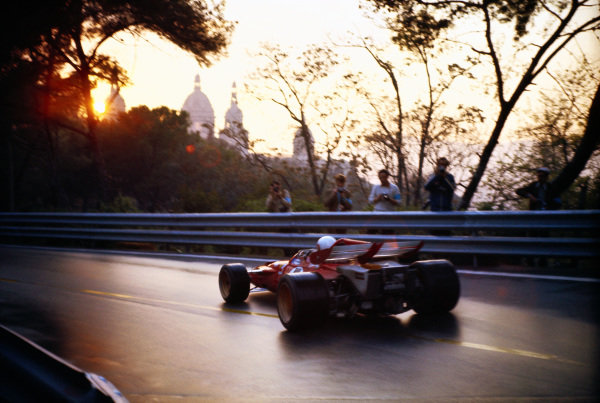 Clay Regazzoni, Ferrari 312B, on a damp track during practice as the sun begins to set.