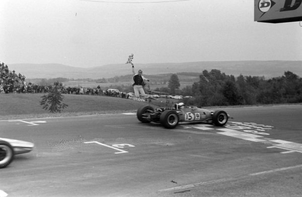 Jackie Stewart, Matra MS10 Ford, crosses the finish line and takes the chequered flag.
