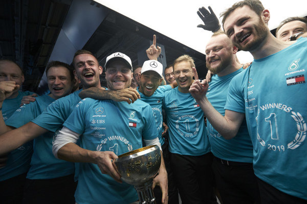 Valtteri Bottas, Mercedes AMG F1 and Lewis Hamilton, Mercedes AMG F1 join other members of the AMG Mercedes F1 team celebrate winning the Constructors' World Championship