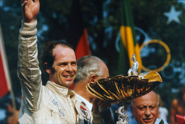Monza, Italy. 3rd - 5th September 1971.Peter Gethin (BRM P160), 1st position, on the podium with the trophy.  Ref: 71ITA62. World Copyright: LAT Photographic.